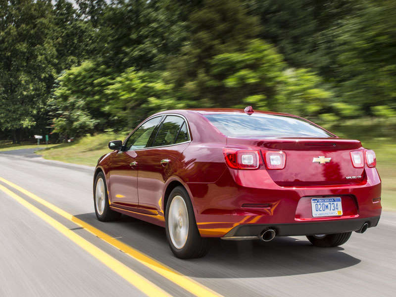 ABTL_2015-Chevrolet-Malibu-LTZ-Butte-Red-Metallic-Rear-Quarter-At-Speed.jpg