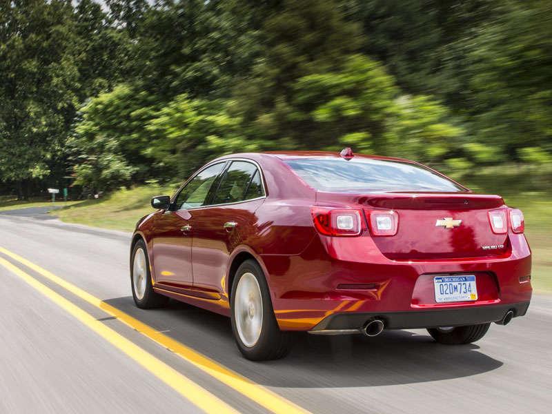 ABTL_2015-Chevrolet-Malibu-LTZ-Butte-Red-Metallic-Rear-Quarter-At-Speed.jpg